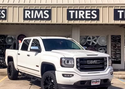 GMC Truck with Window tint and a lift Kit
